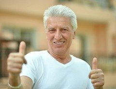 older man thumb up smiling