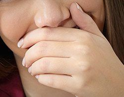 Closeup of person covering mouth
