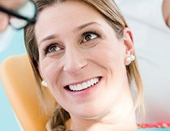 Smiling woman in dental chair