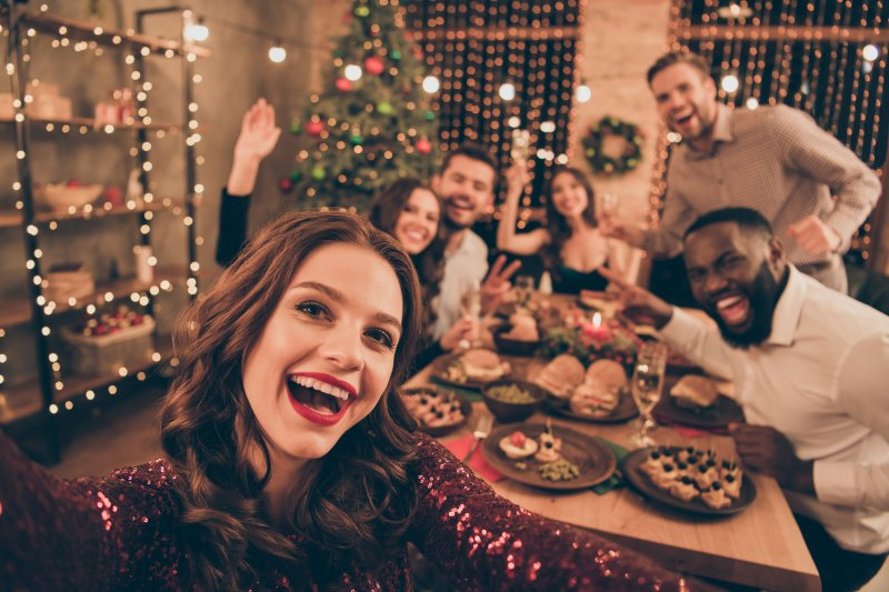 Group of friends smiling during festive dinner
