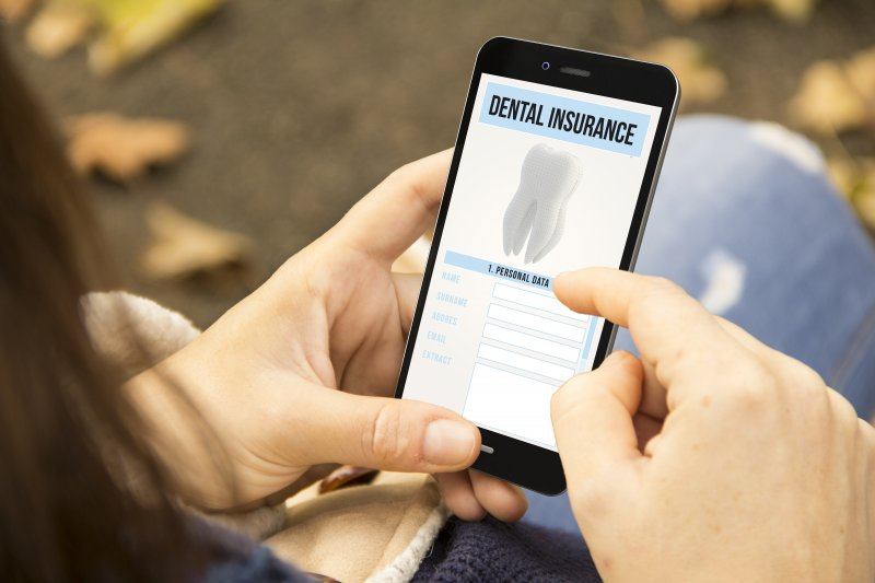Woman looking at dental insurance benefits on phone