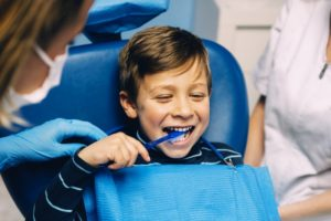 young boy seeing his family dentist in Newark