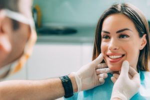 cosmetic dentist in newark talking to patient