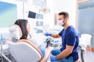 woman talking to dentist in Newark