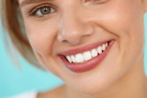 Woman with beautiful smile thanks to Newark cosmetic dentist