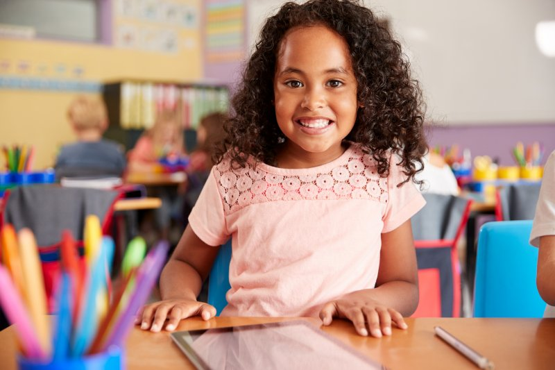 young girl smiling in school